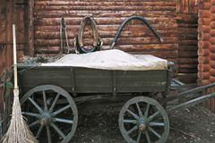 Telega. The Russian type of wagon, in a yard with harness hanging behind. Horizontal shot Royalty Free Stock Photography