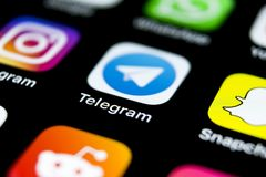 Telegram application icon on Apple iPhone X screen close-up. Telegram app icon. Telegram is an online social media network. Social Royalty Free Stock Photography