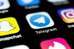 Telegram application icon on Apple iPhone X screen close-up. Telegram app icon. Telegram is an online social media network. Social Royalty Free Stock Photos