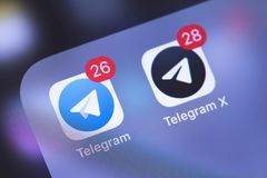 Telegram apps icons on the screen smartphone. Telegram is an onl royalty free stock image