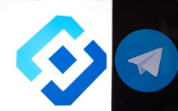 Telegram messenger and the Roskomnadzor emblem. MOSCOW, RUSSIA, April 17, 2018. The application icon of the Telegram messenger and the Roskomnadzor emblem Royalty Free Stock Photography