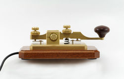 Telegraph Key - 2. Close-up view of a straight-key used for sending Morse-Code.  This key is beautifully fashioned in solid brass and has a lovely knob turned Royalty Free Stock Images