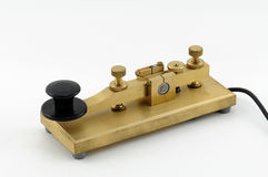 Telegraph Key - 3. Close-up view of a straight-key used for sending Morse-Code.  This key is beautifully fashioned in solid brass and has a solid brass base Royalty Free Stock Photos