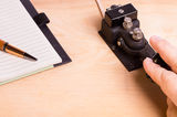 Telegraph key and notebook Stock Images