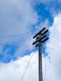 Telegraph pole over blue sky Royalty Free Stock Photo