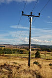 A  telegraph pole on Scotland highland mountain Royalty Free Stock Image
