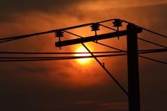 Telegraph Pole Sunrise. High voltage poles on background of sun rise Stock Photos