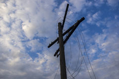 Telegraph pole with torn wires stock photography