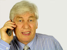 Telehone call. Tallking on the telephone happily Royalty Free Stock Images
