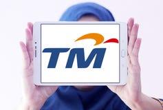 Telekom Malaysia Berhad  , TM , logo. Logo of Telekom Malaysia Berhad , TM , on samsung tablet holded by arab muslim woman. Telekom Malaysia is Malaysia's Stock Photography