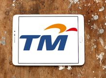 Telekom Malaysia Berhad  , TM , logo. Logo of Telekom Malaysia Berhad , TM , on samsung tablet on wooden background. Telekom Malaysia is Malaysia's leading Royalty Free Stock Photo