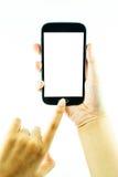 Telemóvel com o écran sensível na mão fêmea no fundo branco imagens de stock