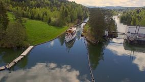 A cruise ship floating on the Telemark canal. The Telemark canal, Norway - CA June 2018: A cruise ship floating on the Telemark canal