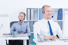 Telemarketers during phone call Royalty Free Stock Image