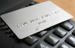 Telemarketing. Credit card over telephone dial Royalty Free Stock Images