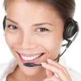 Telemarketing. Woman wearing headset on white background