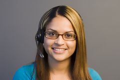 Telemarketing. A woman with a headset Royalty Free Stock Image