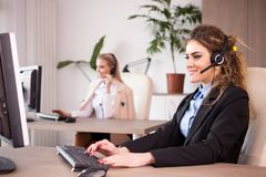 Telemarketing and call center support line. Women working at their desk Stock Photography