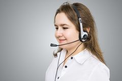 Telemarketing and customer service concept. Young smiling woman - operator. Royalty Free Stock Photos
