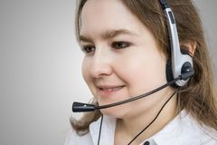 Telemarketing and customer service concept. Young smiling woman Stock Images