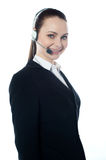 Telemarketing executive offering product. To customer Royalty Free Stock Photos