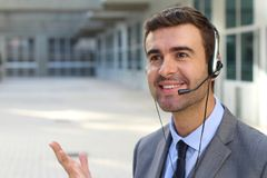Telemarketing operator isolated in office space.  Stock Photography