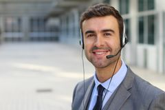 Telemarketing operator isolated in office space.  Stock Photo