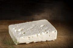 Telemea - Romanian cheese. On wooden background Stock Photos