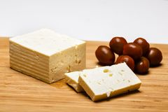 Telemea - Romanian cheese on wooden. Background Stock Image