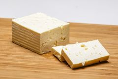 Telemea - Romanian cheese on wooden. Background Royalty Free Stock Photo