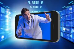 The telemedicine concept with doctor and smartphone stock images
