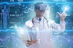 The telemedicine concept with doctor wearing vr glasses stock image
