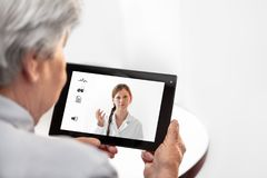 Telemedicine or Telehealth with a Doctor and a senior woman with. Telemedicine or Telehealth with a Doctor and a senior women with tablet, copyspace Royalty Free Stock Photo