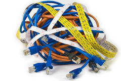 Telemetry. Knot of computer cables and measuring tapes royalty free stock images