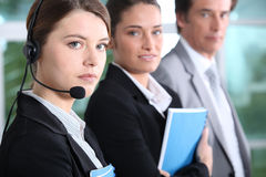 Teleoperator and business people Royalty Free Stock Photo