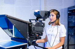 Teleoperator at TV studio. A female cameraman at a studio during live broadcasting Stock Photography