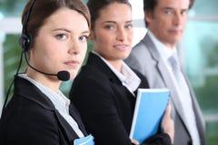 Teleoperator und Geschäftsleute Lizenzfreies Stockfoto