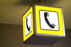 Telephon. A yellow pictogram of a telephone listener Stock Images