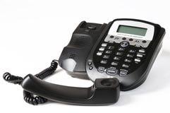 Telephone. Black telephone against white background Royalty Free Stock Images
