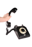 Telephone. Receiver in hand,isolated on white background Royalty Free Stock Images