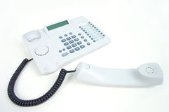 Telephone. White telephone with headset off stock photography