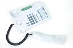 Telephone. White telephone with headset off stock images