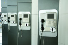Telephone. Four stylish public telephone, communication tools Royalty Free Stock Photo
