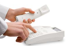 Telephone. Dialing the number on the phone stock photography