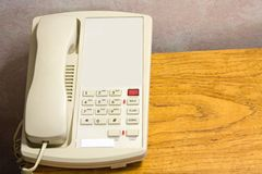 Telephone. In a hotel room sitting on a night stand royalty free stock image