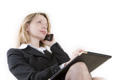 On the telephone. A woman day dreaming on the telephone Stock Photography