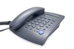 Telephone. Image of grey office telephone over white background Royalty Free Stock Photography