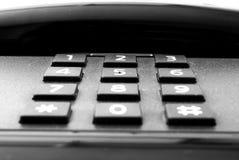 Telephone. One black telephone  number Royalty Free Stock Photo