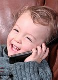 Telephone. Baby talking with the telephone and have fun Royalty Free Stock Photos
