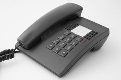 Telephone. Ordinary office black telephone isolated Stock Photo